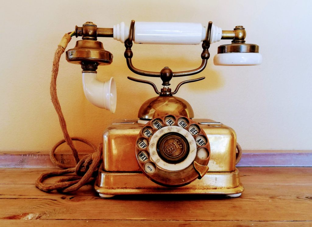 Old bronze phone at Posthouse Restaurant