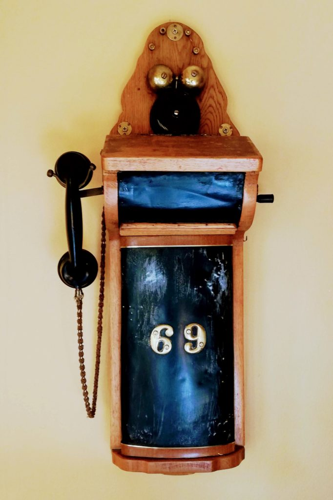Black and Wooden Phone 69 Posthouse Restaurant